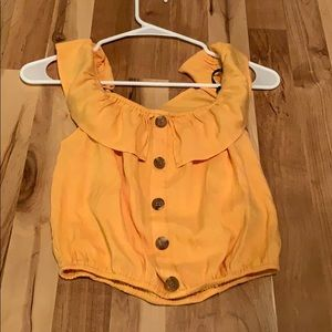 Yellow top with buttons